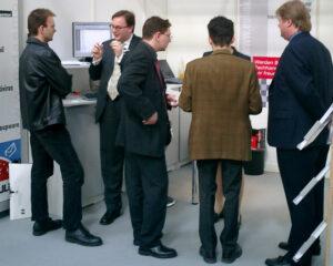 2003: Volker Lang (2. v.l.) und Arvel Hathcock (r.), Gründer von MDaemon-Hersteller MDaemon Technologies, auf der CeBIT